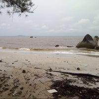 Photo taken at Pantai Romodong by Rico L. on 12/31/2012