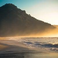 Photo taken at Praia Itamambuca by Luli R. on 1/12/2013