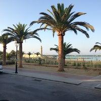 Photo taken at Rethymno Beach by Vaggelis K. on 8/8/2013