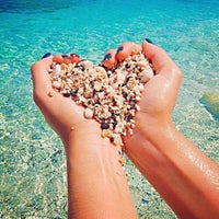 Photo taken at Beach by Şule E. on 7/4/2015