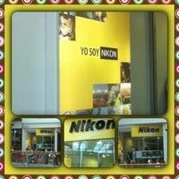 Photo taken at Nikon by Paulinha . on 2/18/2014