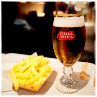 Photo taken at Stella Artois Café by Hidemaro I. on 8/19/2017