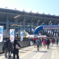 Photo taken at Nissan Stadium by Satoshi S. on 3/16/2013