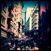 Photo taken at Rua 25 de Março by Grazy A. on 10/28/2012