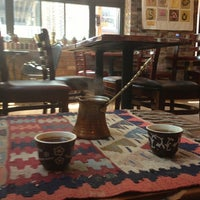 Photo taken at Manakeesh Cafe Bakery by Ethan T. on 7/5/2013
