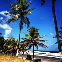 Photo taken at Praia de Ipitanga by Franz Y. on 9/12/2013