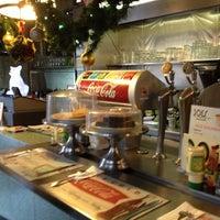 Photo taken at Dog's Café by Vincent M. on 12/15/2012