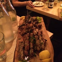 Photo taken at Evoo Greek Kitchen by John T. on 5/25/2014