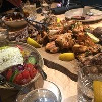 Photo taken at Evoo Greek Kitchen by John T. on 2/18/2017