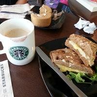 Photo taken at Starbucks by Amelia I. on 3/30/2013