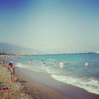 Photo taken at Ünlüselek Beach by Dilek T. on 6/30/2013