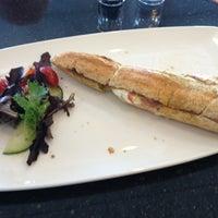 Photo taken at Royale Cafe Vinoteca by Christa K. on 3/27/2013