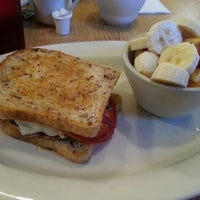 Photo taken at Brass Compass Cafe by Ally P. on 8/11/2013