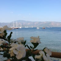 Photo taken at Pause Beach by İsmail A. on 7/6/2013