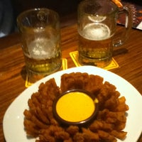 Photo taken at Outback Steakhouse by Flávio M. on 7/21/2013