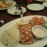 Photo taken at Outback Steakhouse by Waheeda I. on 7/8/2013