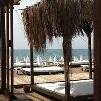 Photo taken at Zuga Beach Club by Semih U. on 5/18/2013