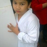 Photo taken at Kuching Taekwondo & Self Defense Academy @Satok by Pikah S. on 5/26/2013
