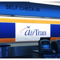 Photo taken at AirTran Airways Ticket Counter by Troy B. on 10/31/2013