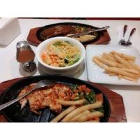Photo taken at Steak 21 by Windy Junia S. on 2/1/2014