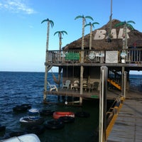 Photo taken at Palapa Bar & Grill by Rebecca C. on 6/18/2014
