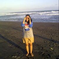 Photo taken at Pantai Kuwaru by Agnes S. on 7/29/2014