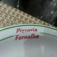 Photo taken at Fornalha Pizzaria by Viviane G. on 5/1/2013