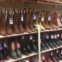 Photo taken at Justin Boots by Katie M. on 11/9/2012