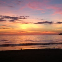 Photo taken at Tanjung Aru 1st Beach by Lee L. on 3/28/2013