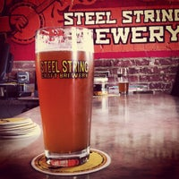 Photo taken at Steel String Brewery by Alex E. on 5/4/2013