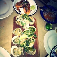 Photo taken at La Docena Oyster Bar & Grill by Maggie I. on 5/3/2013