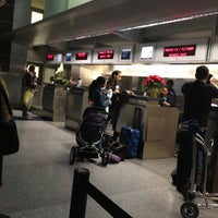 Photo taken at United International Check In by Moises B. on 12/22/2012