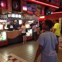 Photo taken at Regal Cinemas Village Park 17 by George B. on 7/3/2013