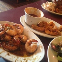 Photo taken at Gumbeaux's Cajun Cafe by Latanya J. on 7/2/2013