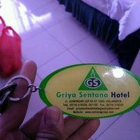 Photo taken at Griya Sentana Hotel by Andi Aulia R. on 8/14/2016