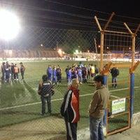 Photo taken at Estadio Luis Maiolino (Club Social y Deportivo Roca) by Juan Pablo S. on 9/25/2014