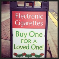 Photo taken at e cigs cary by Robin Werling S. on 10/13/2013