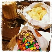 Photo taken at Café Donuts by Bruna R. on 10/8/2014