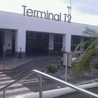 Photo taken at Terminal 2 by Roberto A. on 9/18/2012