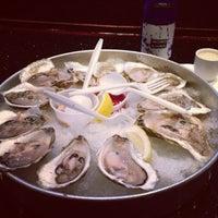 Photo taken at Yoki Japanese Restaurant and Sushi Bar by Nadina on 7/15/2013