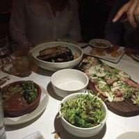 Photo taken at Barcelona Wine Bar - South End by Nadina on 4/5/2015
