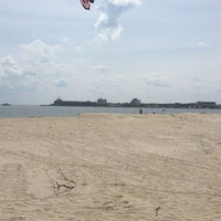Photo taken at Plumb Beach by Kai B. on 6/2/2013