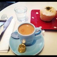 Photo taken at Café des Fleurs by Daniela B. on 11/22/2012