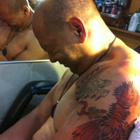 Moth and Dagger Tattoo Studio
