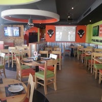 Photo taken at Buffalo Wings & Rings by Mohammad T. on 6/6/2014