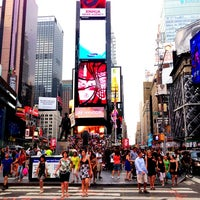 Photo taken at Times Square by Gabriella H. on 7/9/2013