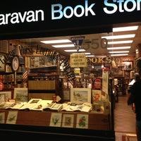Photo taken at Caravan Bookstore by Tashia N. on 7/11/2013
