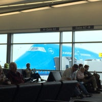 Photo taken at Gate A7 by Nathalie S. on 5/7/2015