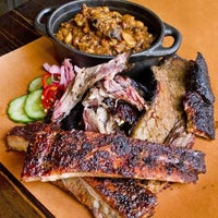 Photo taken at Mighty Quinn's BBQ by New York Post on 5/24/2013