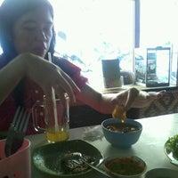 Photo taken at Warung Nasi Tutug Oncom - Bumbu Sunda by Anto H. on 9/29/2012